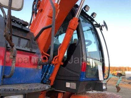 Экскаватор колесный Hitachi ZX145W-3 2011 года во Владивостоке