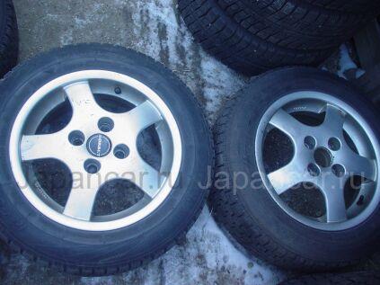 Всесезонные шины Dunlop 175/65 14 дюймов б/у в Уссурийске