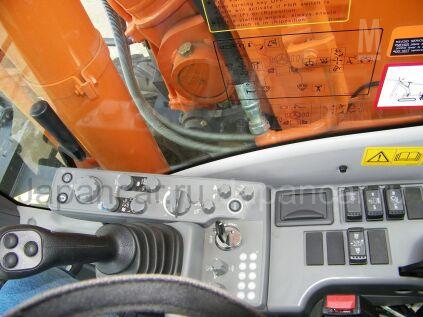 Экскаватор колесный Hitachi Zaxis ZX190W 2012 года во Владивостоке