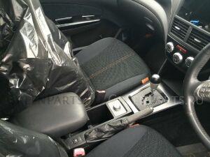 Бардачок между сиденьями на Subaru Forester SH5 EJ205