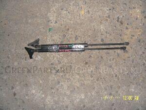 Амортизатор задней двери на Toyota Vitz KSP90 2