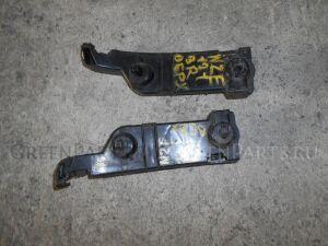Крепление бампера на Toyota Corolla Spacio NZE121