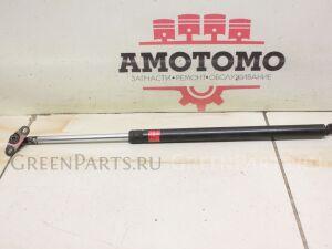 Амортизатор двери на Toyota Corolla AE100 5AFE