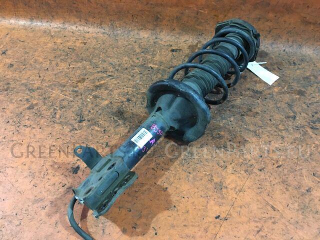 Стойка амортизатора на Mazda Protege BJ