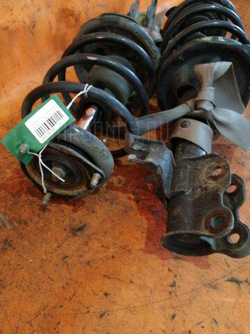 Стойка амортизатора на Nissan Ad Wagon VFY11 QG15DE