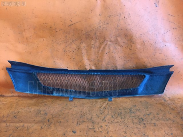 Решетка радиатора на Mazda Demio DW5W