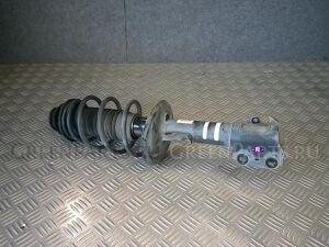 Стойка амортизатора на Toyota Vitz SCP90 2SZ-FE