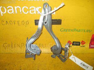 Крепление капота на Toyota Vitz SCP90