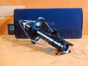 Стойка амортизатора на Nissan Cefiro A33